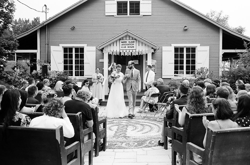 Best-Fine-Art-Wedding-Photographer-Toronto-Analog-Film-Wedding-Photography-Toronto-canada-3b-photography-Vintage-bride-and-groom-Toronto-Island-Cafe-wedding-venue-clubhouse-ceremony-detail-bride-and-groom-exit-BW-film.jpg