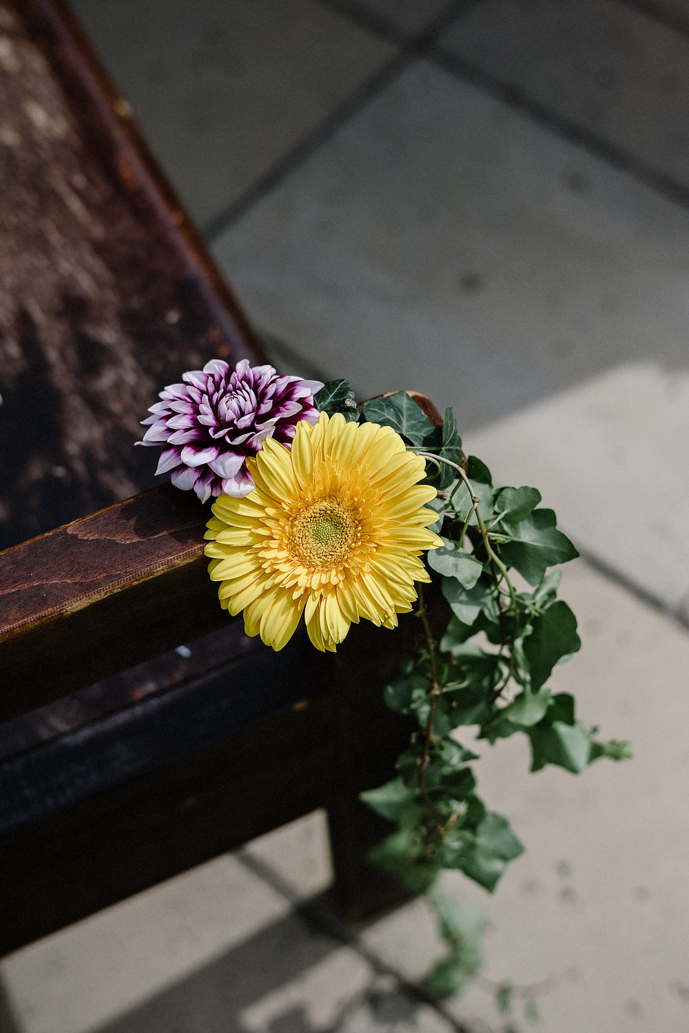 Best-Wedding-Photographers-Toronto-with-a-documentary-photojournalistic-approach-and-style-Toronto-Island-Cafe-Clubhouse-Wedding-Photography-Hip-Cool-Bride-and-Groom-Island-Cafe-Exterior-Flowers.jpg