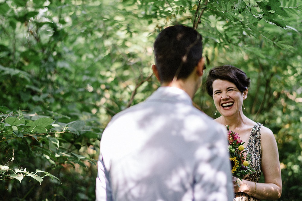 Best-Photojournalistic-Wedding-Photographer-Toronto-Documentary-Style-Wedding-Photography-Boho-Bride-and-Groom-Hipster-Wedding-Toronto-Island-Cafe-Clubhouse-Candid-emotion-from-bride-smile.jpg