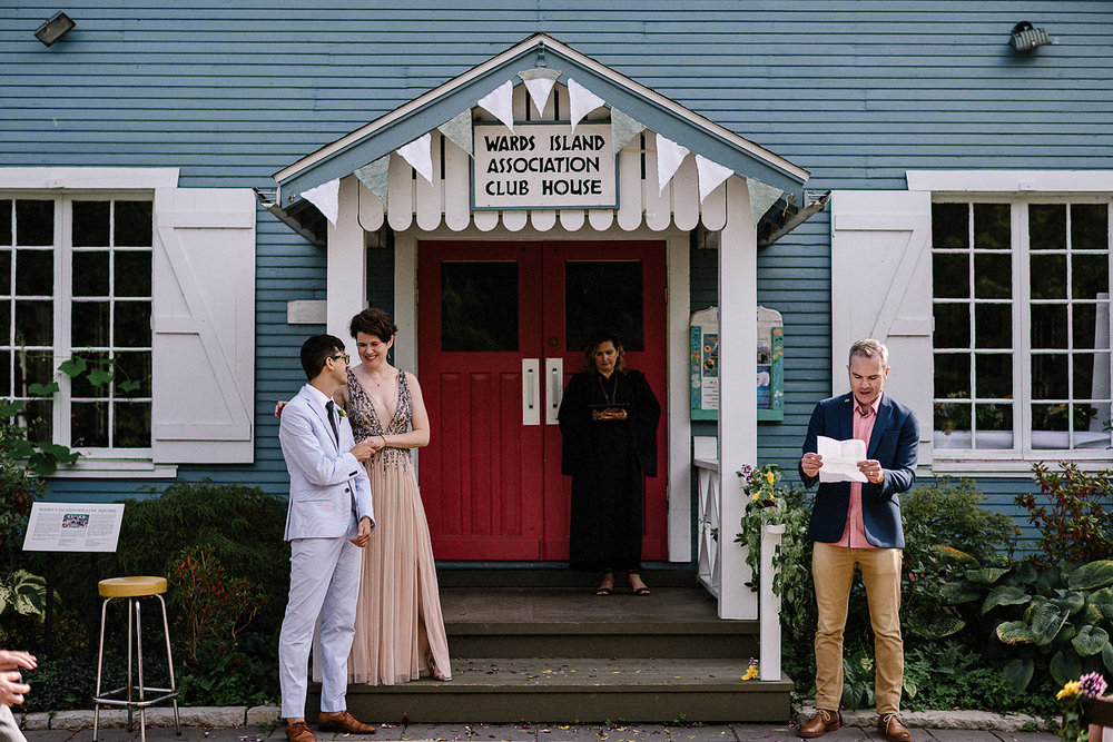 Toronto-Island-Cafe-Club-house-wedding-ceremony-photography-best-photojournalistic-documentary-wedding-photographers-toronto-hip-boh-cool-bride-and-groom-emotional-intimate-toronto-island-wedding-ceremony-candid-emotion-wide-angle-moment.jpg