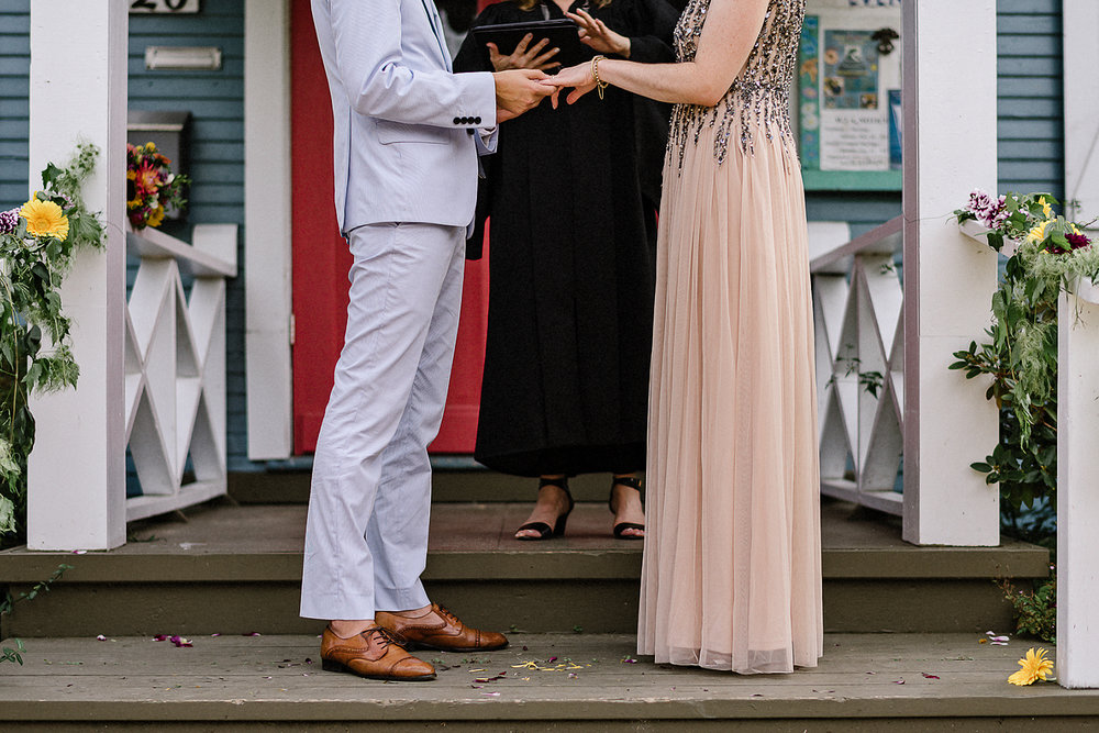 Toronto-Island-Cafe-Club-house-wedding-ceremony-photography-best-photojournalistic-documentary-wedding-photographers-toronto-hip-boh-cool-bride-and-groom-emotional-intimate-toronto-island-wedding-ceremony-candid-ring-exchange.jpg