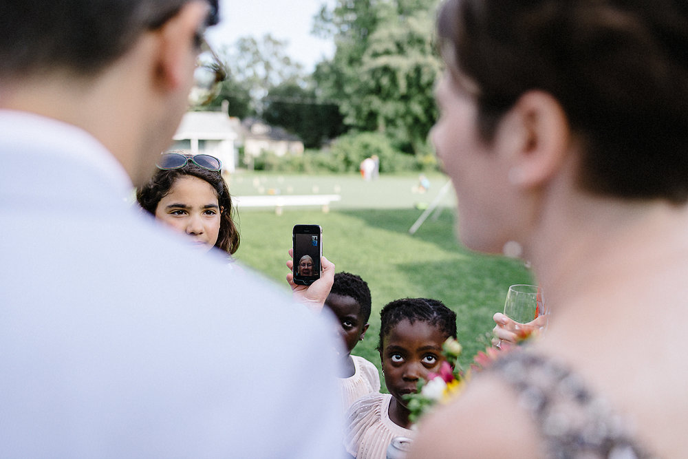Toronto-Island-Cafe-Club-house-wedding-ceremony-photography-best-photojournalistic-documentary-wedding-photographers-toronto-hip-boh-cool-bride-and-groom-emotional-intimate-toronto-island-wedding-ceremony-candid-first-kiss-moment-face-time.jpg
