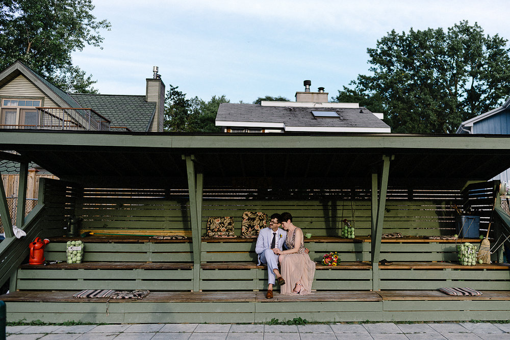 Best-Photographers-in-Toronto-with-Photojournalistic-Documentary-Style-3B-Photography-Intimate-Vintage-Wedding-at-Toronto-Island-Cafe-Clubhouse-Sunset-portraits-on-Tennis-Court-Fine-Art-Wedding-Photographer--Beautiful-Quiet-Moment-Kodak-Film.jpg