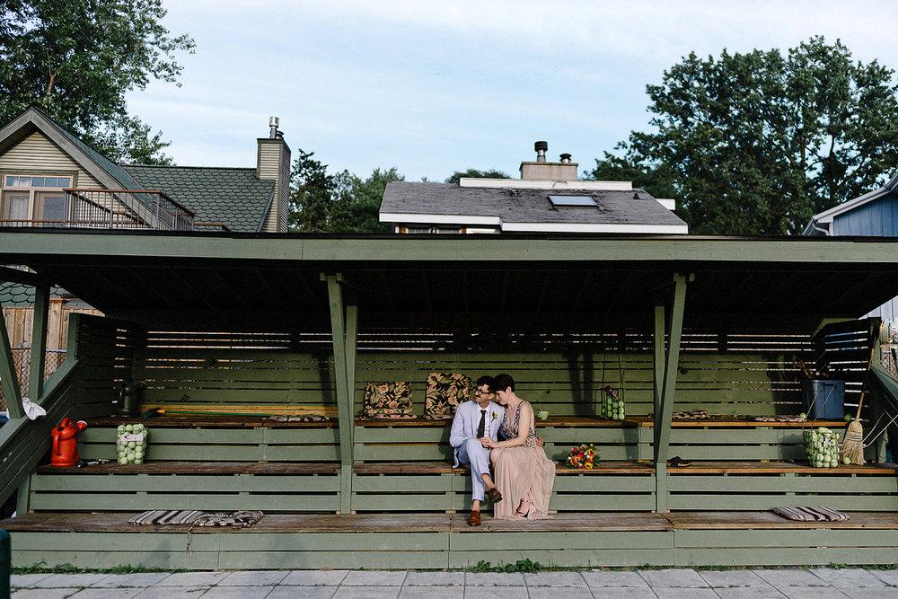 Best-Photographers-in-Toronto-with-Photojournalistic-Documentary-Style-3B-Photography-Intimate-Vintage-Wedding-at-Toronto-Island-Cafe-Clubhouse-Sunset-portraits-on-Tennis-Court-Fine-Art-Wedding-Photographer--Beautiful-Quiet-Moment-Kodak-Film.jpg