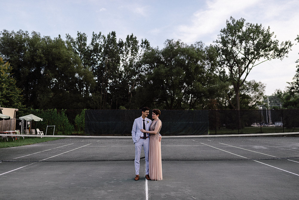 Best-Wedding-Photographers-in-Toronto-with-Photojournalistic-Documentary-Style-3B-Brian-Batista-Bettencourt-Intimate-Vintage-Wedding-at-Toronto-Island-Cafe-Clubhouse-Sunset-portraits-quiet-moment-intimate-candid-Groom-style-Bride-Tennis-Court.jpg