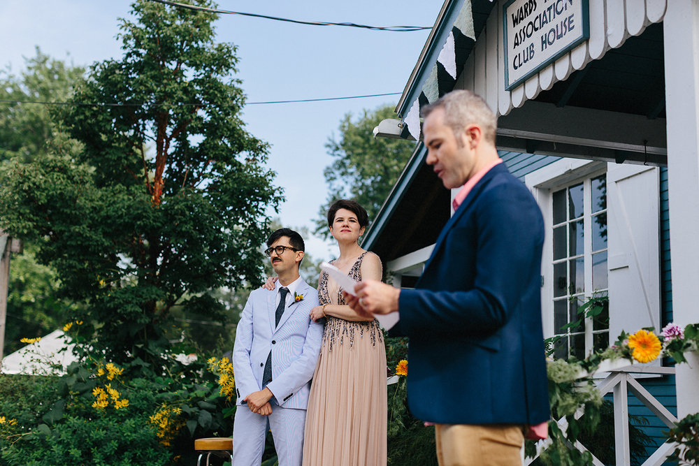 Best-Photographers-Toronto-Analog-Film-Toronto-Island-Wedding-Wards-Island-Clubhouse-Venue-small-intimate-hipster-alternative-vintage-inspired-wedding-ceremony-outdoor-candid-bride-and-groom-vows-guests-watching-personailized-ceremony-unique.jpg