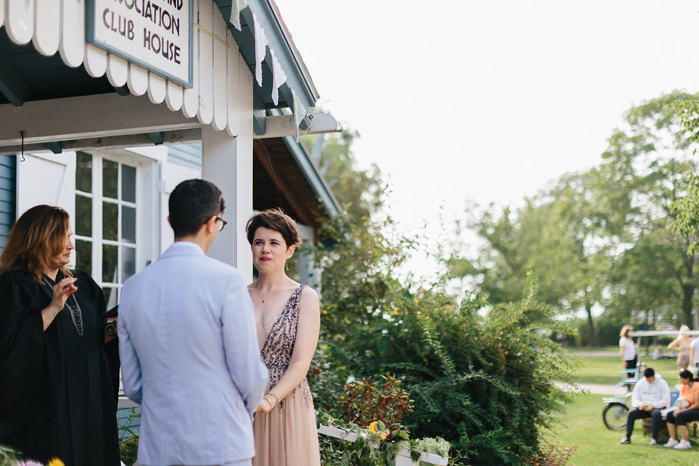Best-Photographers-in-Toronto-Analog-Film-Toronto-Island-Wedding-Wards-Island-Clubhouse-Venue-small-intimate-hipster-alternative-vintage-inspired-wedding-ceremony-personalized-bride-and-groom-vows.jpg