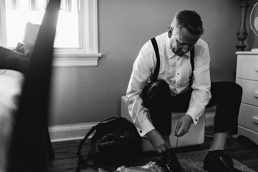 Toronto-Wedding-Photographers-with-natural-photojournalistic-documentary-style-3b-photo-Niagara-on-the-Lake-Wedding-Getting-REady-in-Port-Dalhousie-Groom-shoes.jpg