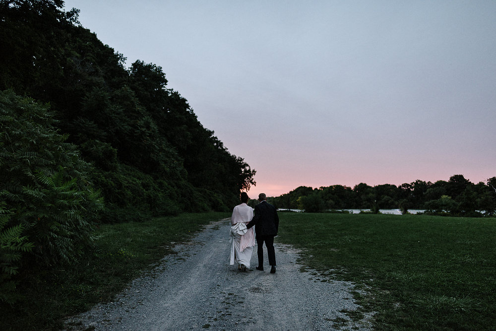 Best-Wedding-Photographers-Toronto-3B-photo-Brian-B-Bettencourt-Candid-Natural-Photojournalistic-Documentary-wedding-photography-candid-outdoor-sunset-portraits-near-water-pink-sky-beautiful-moment-intimate-Orange-Sky.jpg