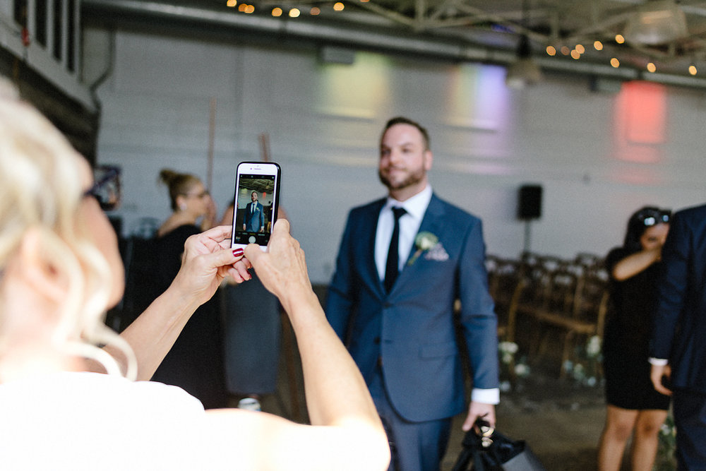 Toronto-Wedding-Photographers-3B-Photography-Airship37-Wedding-Photos-Documentary-Photojournalistic-Wedding-Photography-Venue-Details-Candid-Groom-Phone-Selfie.jpg