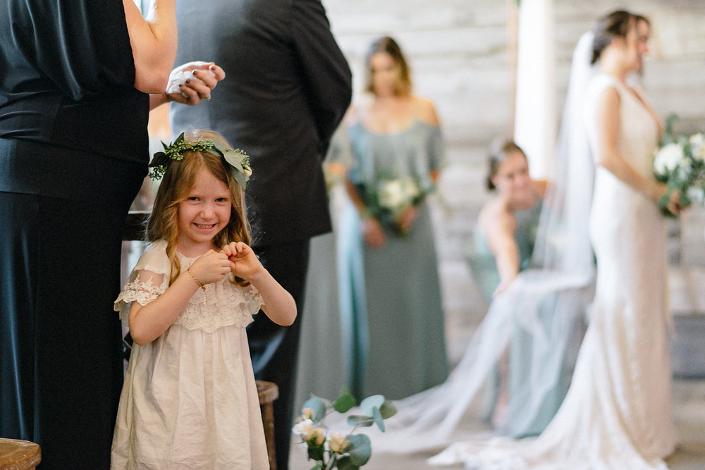 Best-Wedding-photographers-Toronto-NAtural-Candid-wedding-photography-Airship37-Wedding-Ceremony-Entrance-Candid-Moment-Flower-Girl-laughing-at-me.jpg
