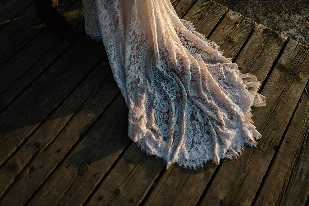 Best-Wedding-photographers-Toronto-NAtural-Candid-wedding-photography-Airship37-Sunset-Portrait-bride-and-veil-sunset-golden-light-toronto-skyline-portraits-candid-intimate-wedding-dress-detail.jpg