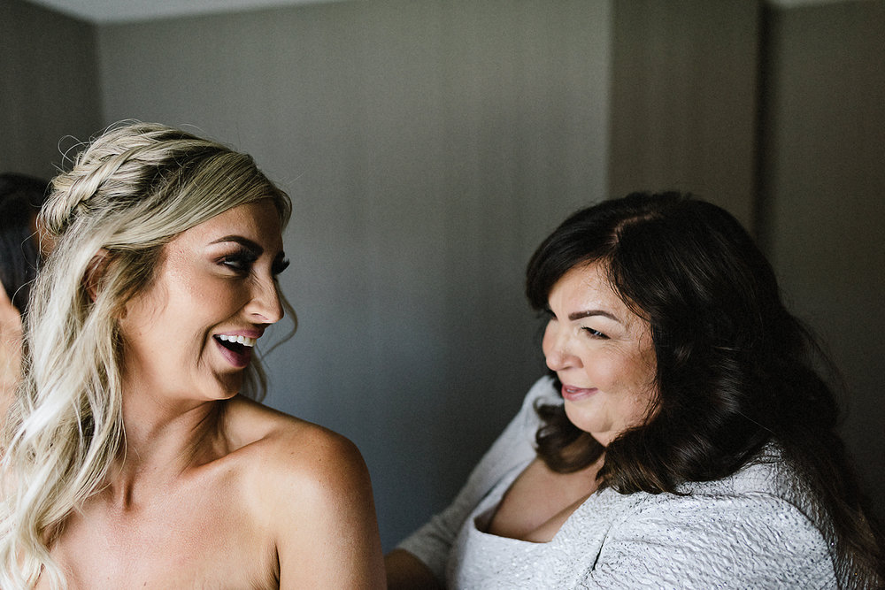 dowswell-barn-wedding-beaverton-best-wedding-photographers-toronto-moody-style-candid-photojounalistic-approach-intimate-vintage-farm-wedding-foggy-morning-details-bride-getting-ready-room-bride-and-mother-moment.jpg