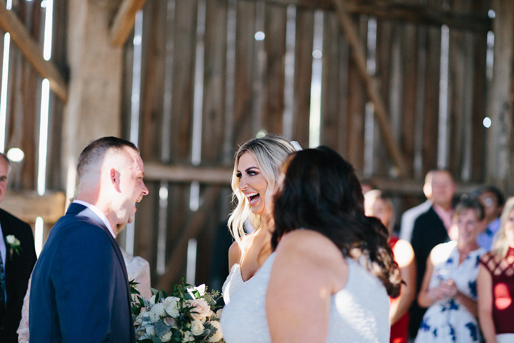 Photojournalistic-Wedding-Photographers-in-Toronto-Candid-Natural-Dowswell-Barn-Wedding-Rustic-GTA-Muskoka-Farm-ceremony-groom-waiting-for-bride-emotional-excited.jpg