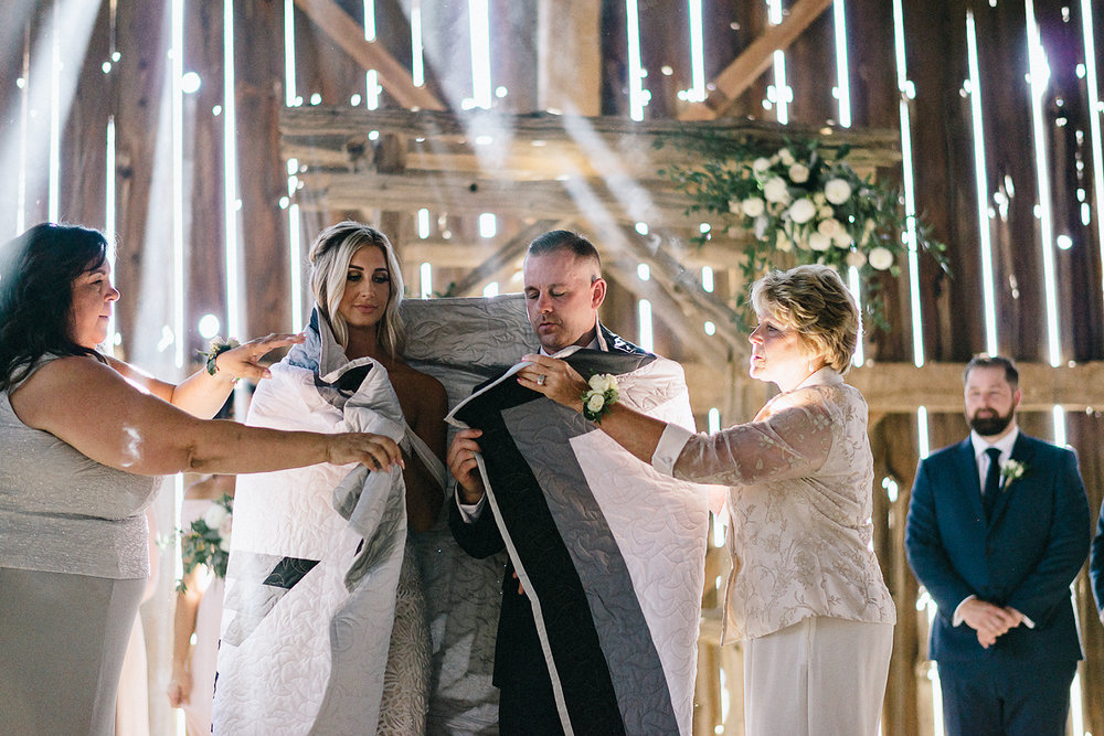dowswell-barn-wedding-beaverton-best-wedding-photographers-toronto-moody-style-candid-photojounalistic-approach-intimate-vintage-farm-wedding-Farm-wedding-venue-details-ceremony-bride-and-groom-aboriginal-traditional-ceremony-candid-moment.jpg