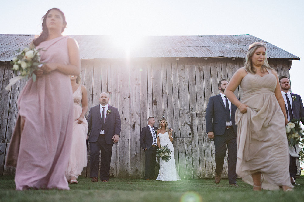 dowswell-barn-wedding-beaverton-best-wedding-photographers-toronto-moody-style-candid-photojounalistic-approach-intimate-vintage-farm-wedding-Farm-wedding-bridal-party-candid-portrait.jpg