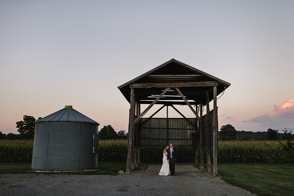 Best-Wedding-Photographers-Toronto-with-Documentary-and-photojournalistic-style-3b-Photography-Intimate-Wedding-at-Dowswell-Barn-Wedding-Photography-Bride-and-groom-intimate-wedding-stunning-portrait-during-pink-sunset.jpg