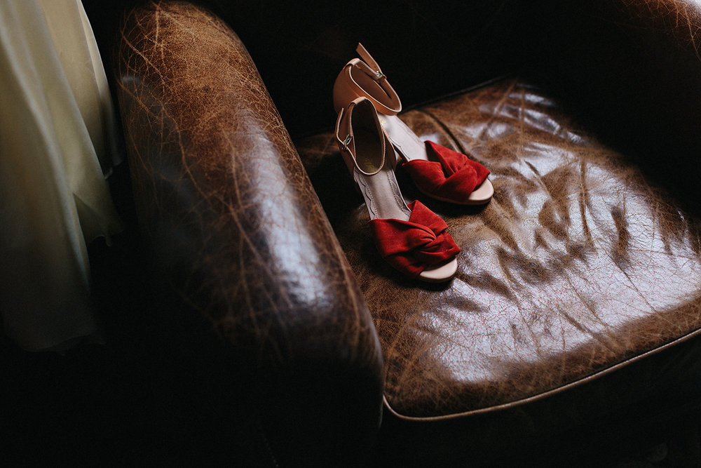 fine-art-vintage-wedding-shoes-red-heels-Toronto-Elopement-at-the-Drake-Hotel-Torontos-Best-elopement-photographers-candid-documentary.jpg