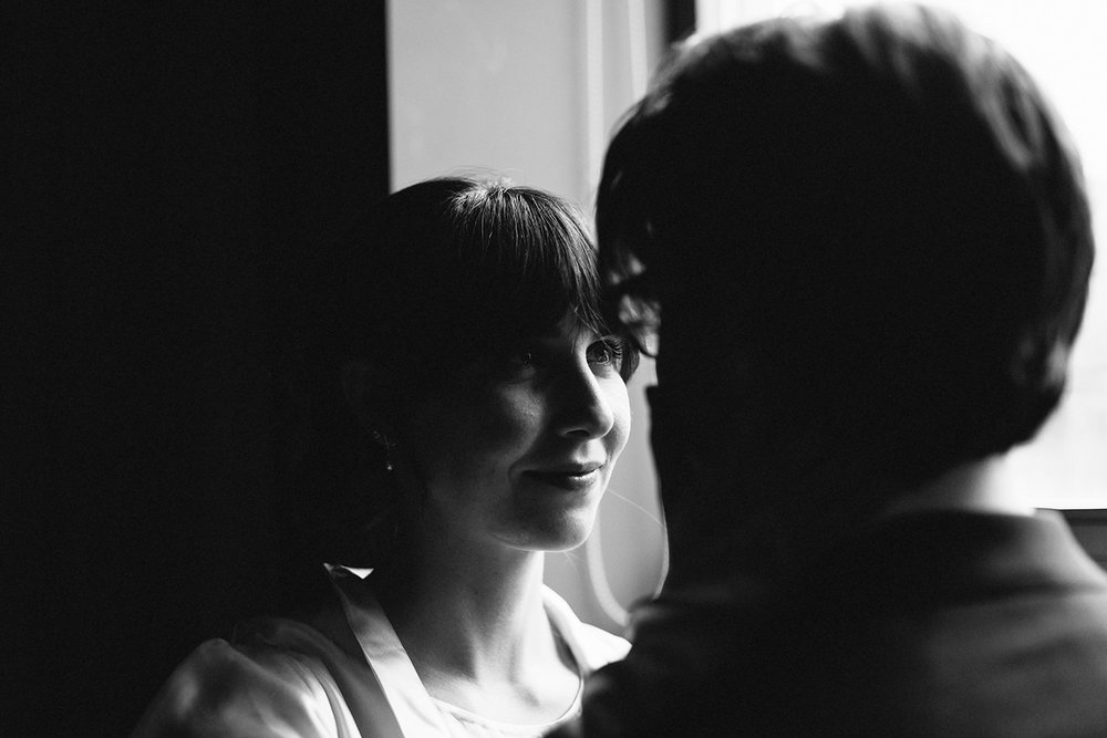 bw-moody-details-analog-editorial-tattooed-bride-and-groom-portraits-by-window-in-boutique-hotel-vintage-elopement-inspiration-bouquet-by-timberlost-Toronto-Elopement-at-the-Drake-Hotel-Torontos-Best-elopement-photographers-candid-documentary.jpg