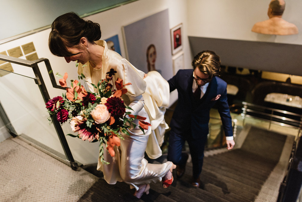 walking-bride-and-groom-portraits-on-film-vintage-bouquet-by-coriander-girl-sky-yard-moody-candlelit-cinematic-Toronto-Elopement-at-the-Drake-Hotel-pop-up-Torontos-Best-wedding-photographers-candid-documentary-photojournalistic.jpg
