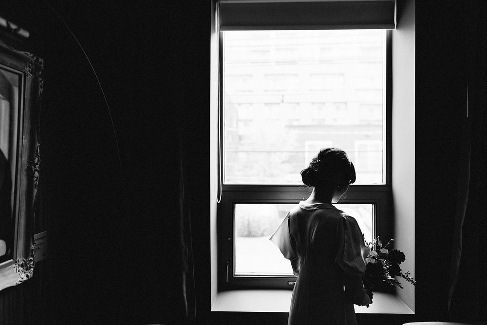 bw-bride-in-vintage-wedding-dress-portraits-by-window-moody-editorial-Toronto-Elopement-at-the-Drake-Hotel-pop-up-Torontos-Best-wedding-photographers-candid-documentary-photojournalistic.jpg