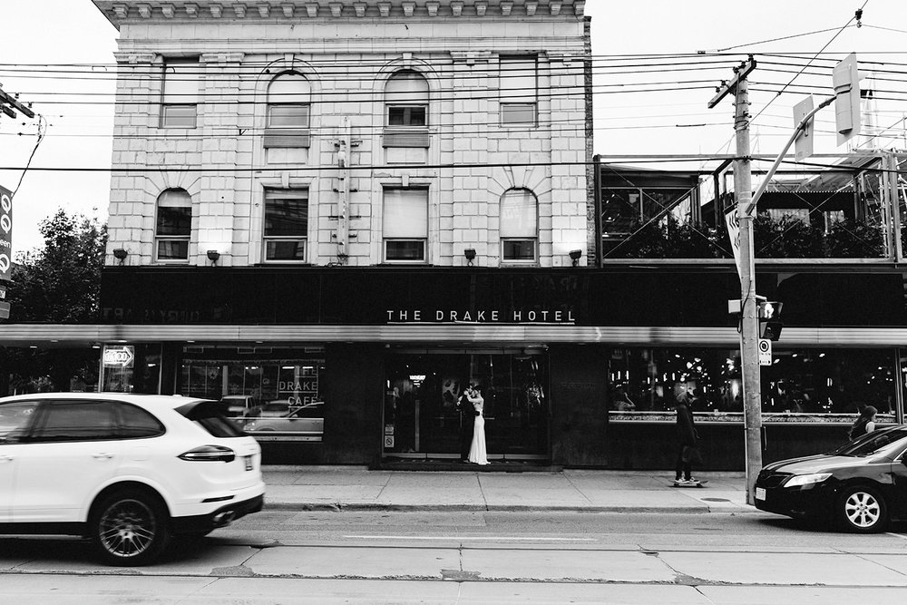 bw-couples-portraits-at-the-drake-hotel-front-entrance-epic-moody-editorial-Toronto-Elopement-at-the-Drake-Hotel-pop-up-Torontos-Best-wedding-photographers-candid-documentary-photojournalistic.jpg