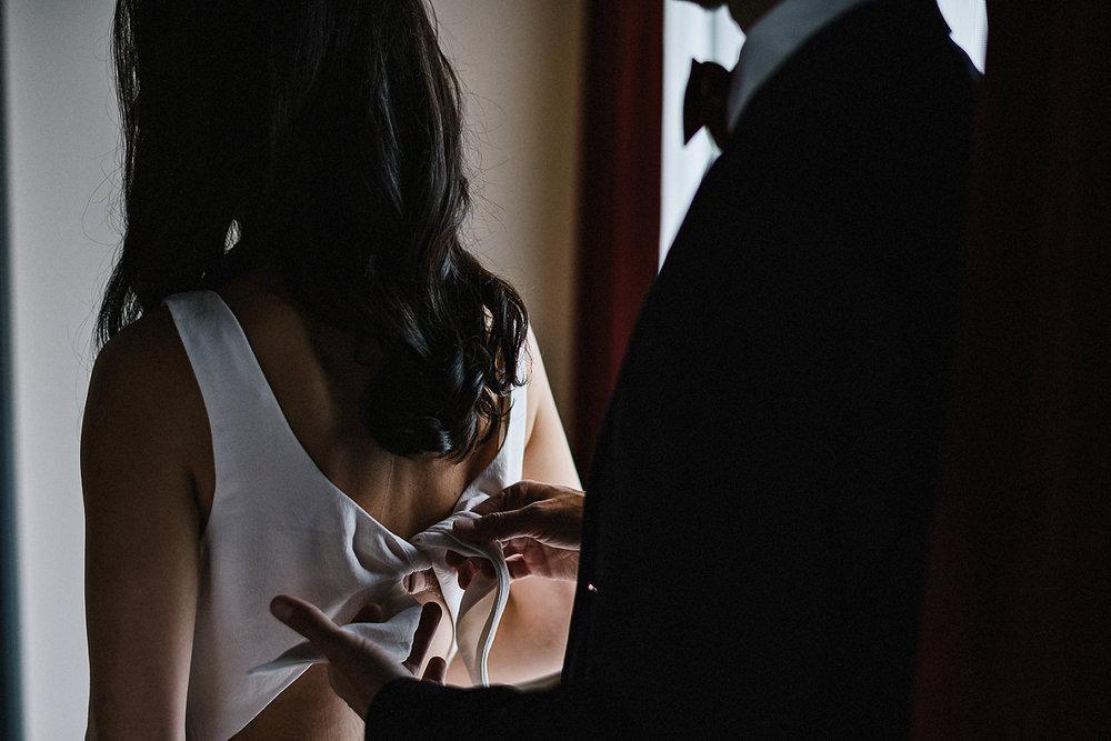 21-525-Best-Wedding-Photography-Toronto-Ontario-Canada-Photojournalistic-Genuine-Candid-Moments-Groom-Helping-Bride-Get-dressed.jpg