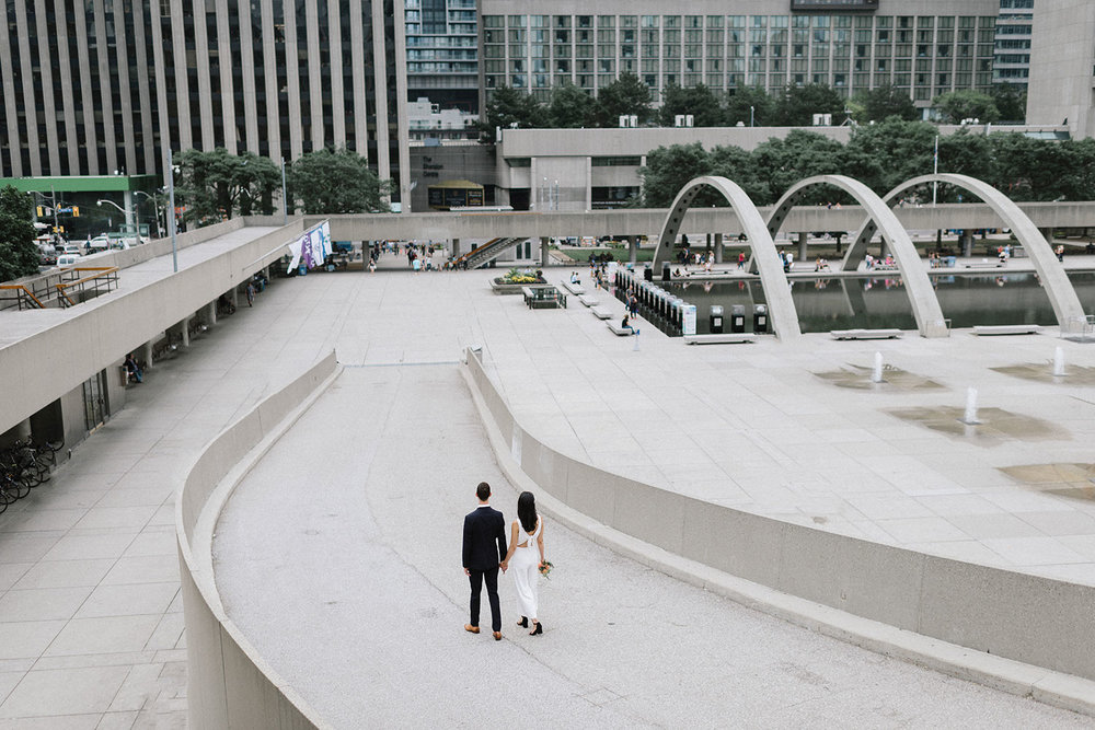 60-536-bBest-City-Hall-Elopement-Photography-Toronto-Ontario-Canada-Urban-Summer-Wedding-Vintage-Bride-and-Groom-Candid-Genuine-Moments-Documentary-Photojournalistic-Style-First-Kiss.jpg