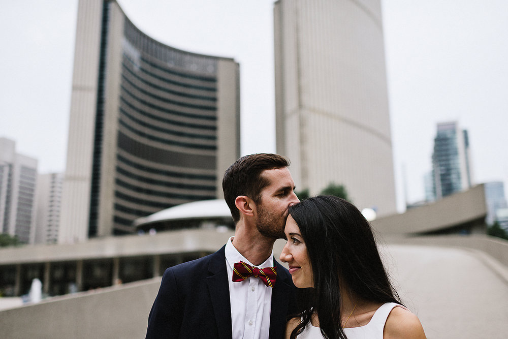 63-553-Best-City-Hall-Elopement-Photography-Toronto-Ontario-Canada-Urban-Summer-Wedding-Vintage-Bride-White-Aritzia-Jumpsuit-as-outfit-Epic-Candid-Moment.jpg