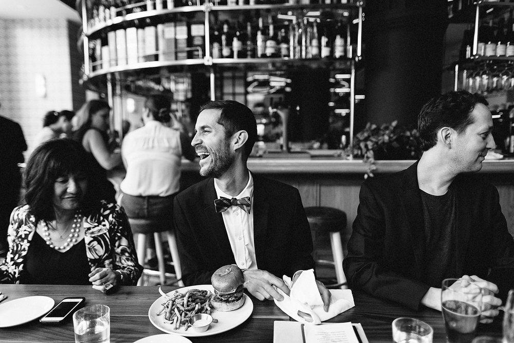 67-388-1-Toronto-Wedding-Venues-Broadview-Hotel-Urban-Boho-Bride-and-Groom-Best-Wedding-Photographers-GTA-Ontario-Groom-Eating-Burger.jpg