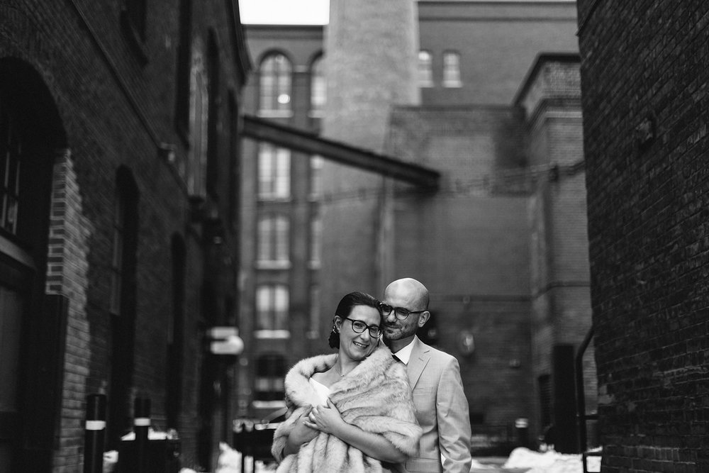 13-couples-portraits-liberty-village-real-wedding-toronto-wedding-photographer-analog-film-candid-documentary-moments-old-toronto-06.jpg