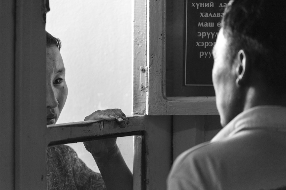 Moron, Mongolia  A scene that plays out every day. The hospital staff greet concerned family members through this wooden hatch, to deliver either the good news or the bad. There is an intimacy here that I watched several times, a respect for the doctors and nursing staff and a stoicism that made it almost impossible to read which way the news went.