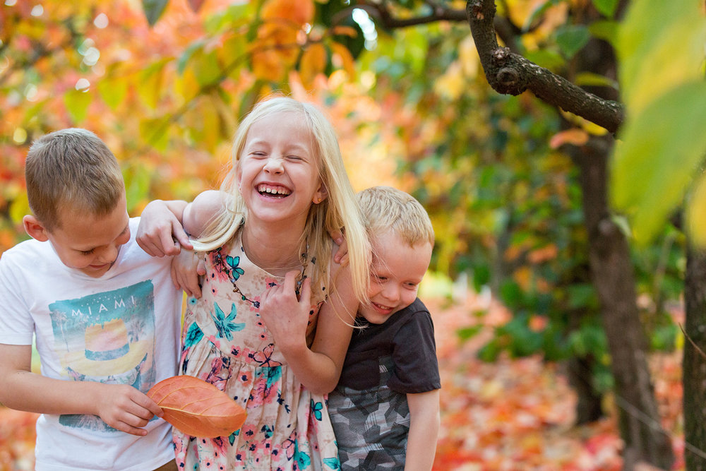 children-laughing-in-the-orchard-in-perth.jpg