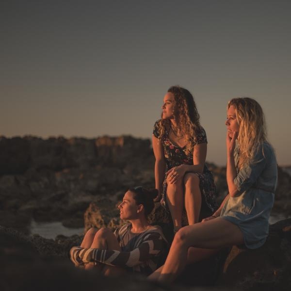 I Am Surf Film Festival-Blue Road-Girls watching sunset on beach.jpg