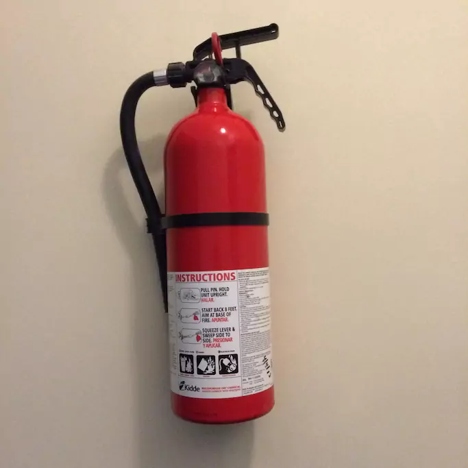 17 Fire extinguisher outside apartment door.png