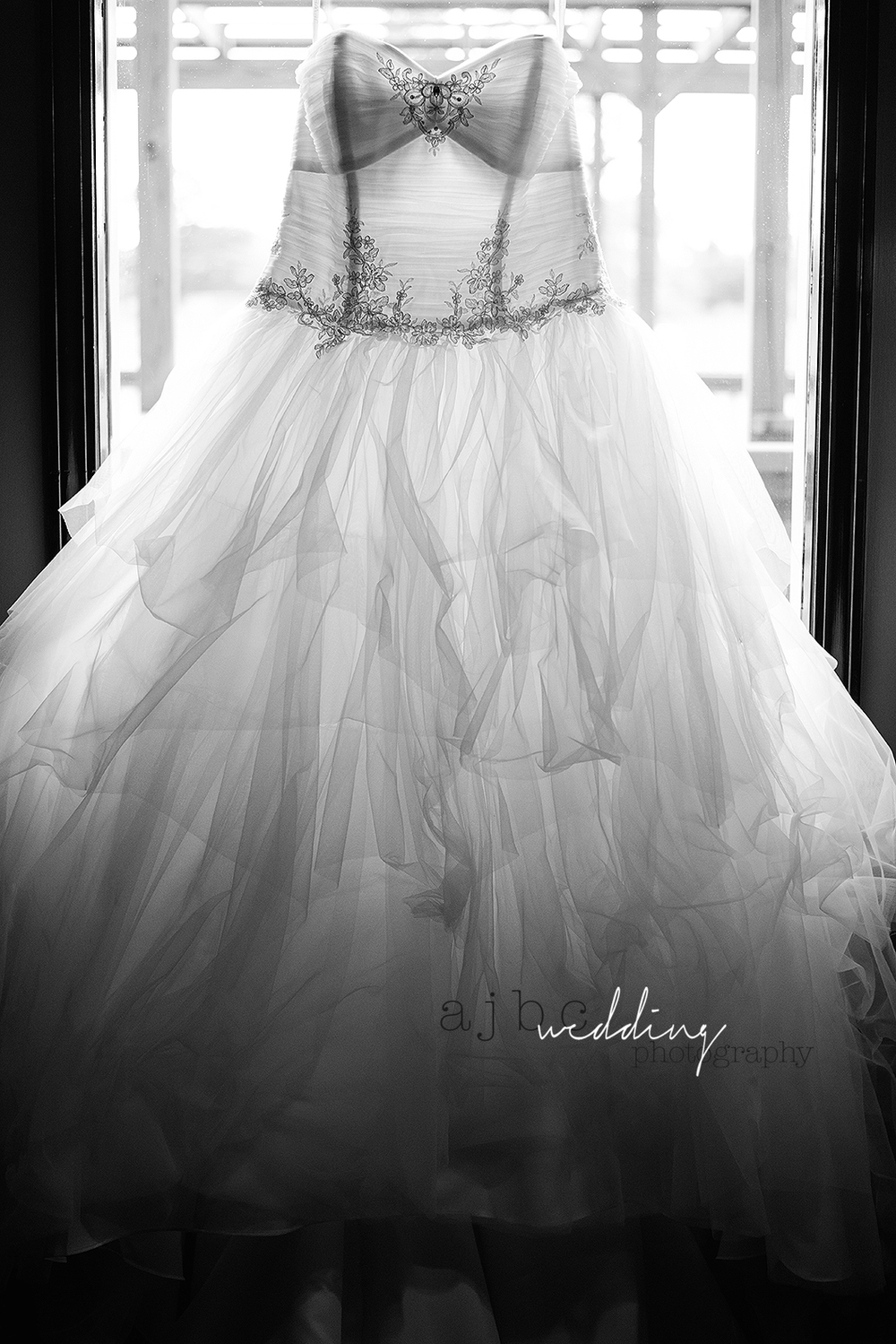 ajbcphotography-port-huron-michigan-wedding-photographer-love-bride-groom-family-michigan-wedding-photographer-wedding-dress-window.jpg