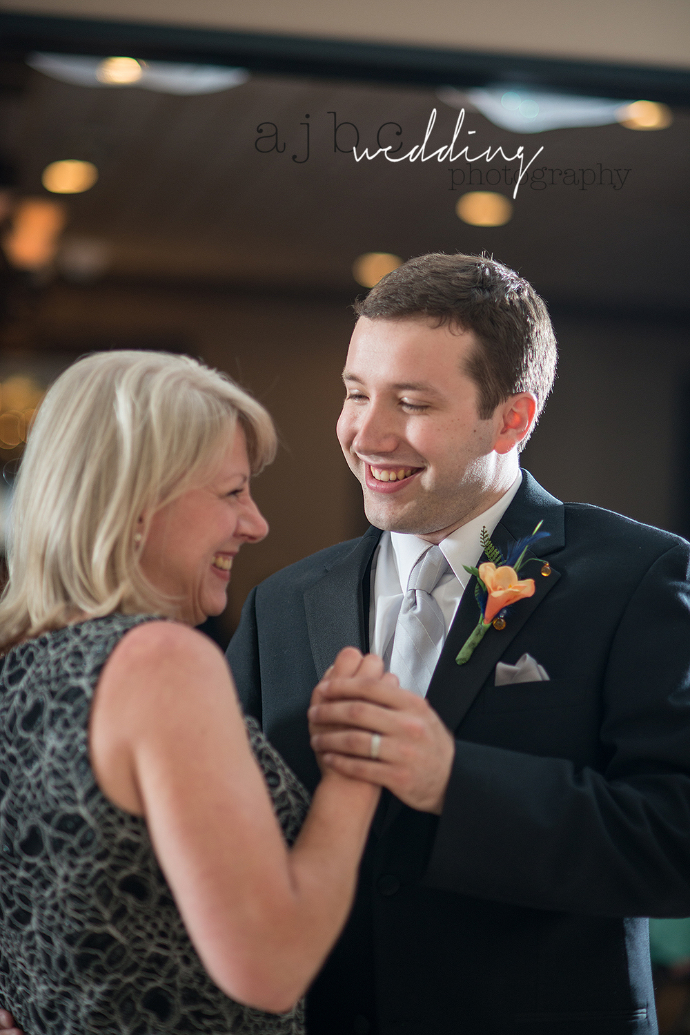 ajbcphotography-port-huron-michigan-wedding-photographer-love-bride-groom-family-michigan-wedding-photographer-mother-son-dance.jpg