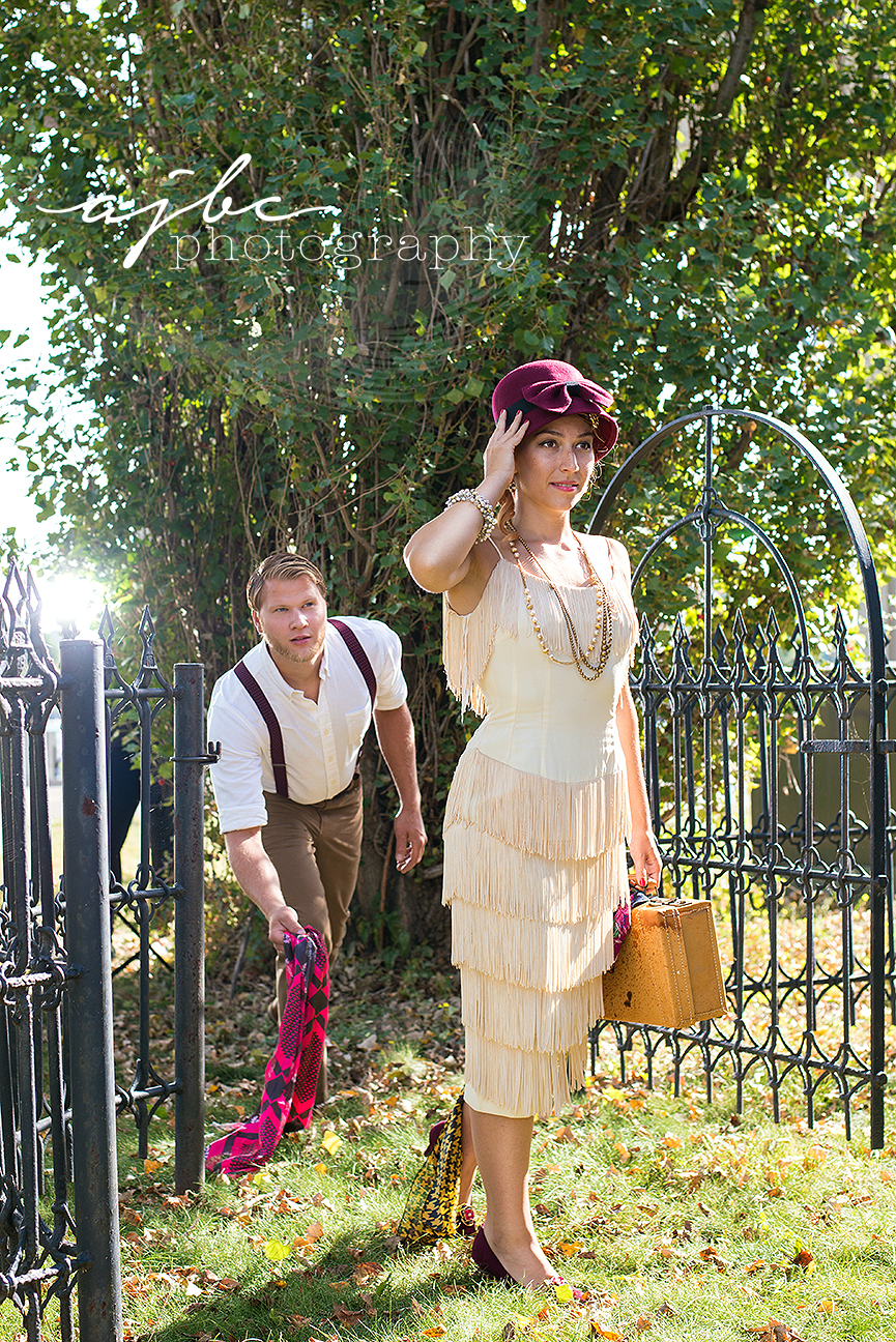 ajbcphotography-porthuron-michigan-photographer-engagement-photoshoot-michigan-ring-i-do-love-classic-vintage-old-fashion-trainstop-port-huron-museum-train-station-flapper-dress-vintage.jpg