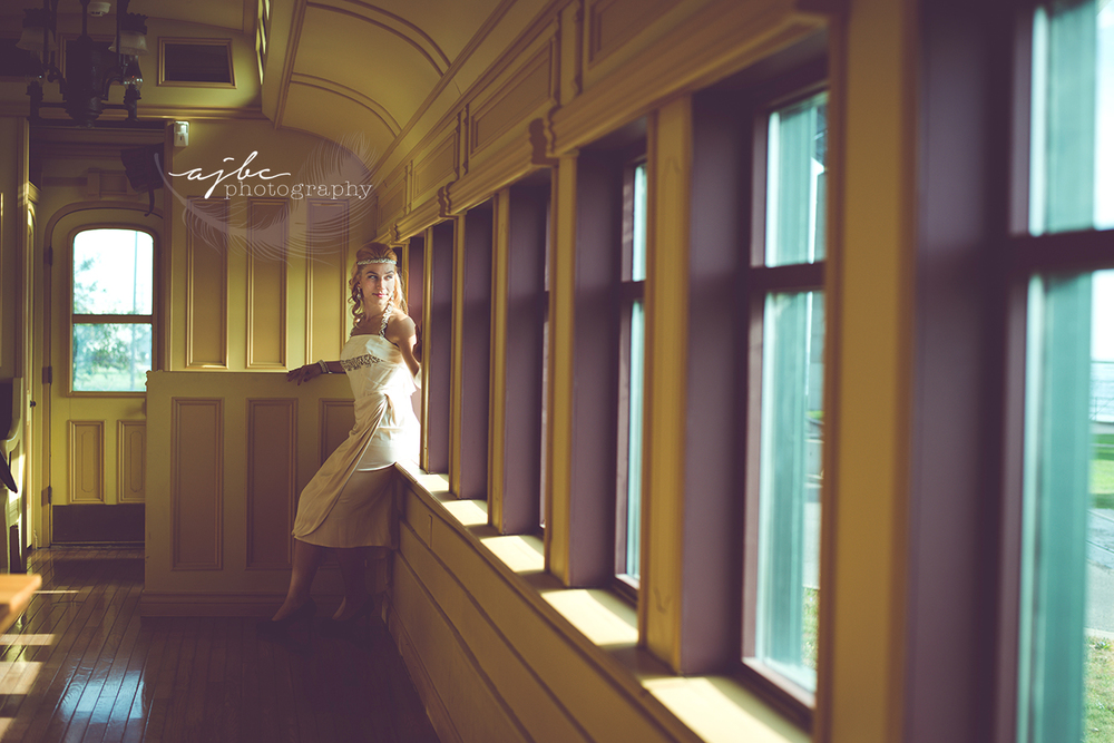 ajbcphotography-porthuron-michigan-photographer-engagement-photoshoot-michigan-ring-i-do-love-classic-vintage-old-fashion-trainstop-port-huron-museum-train-station-love-flapper-dress-egagement-session.jpg