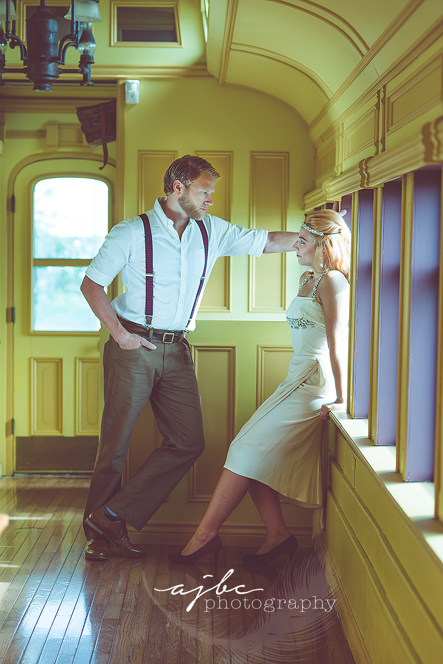 ajbcphotography-porthuron-michigan-photographer-engagement-photoshoot-michigan-ring-i-do-love-classic-vintage-old-fashion-trainstop-port-huron-museum-train-station-love-flapper-dress-wedding-photographer.jpg