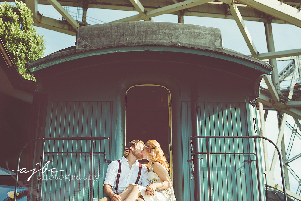 ajbcphotography-porthuron-michigan-photographer-engagement-photoshoot-michigan-ring-i-do-love-classic-vintage-old-fashion-trainstop-port-huron-museum-train-station-love-flapper-dress-happy-vintage-session.jpg