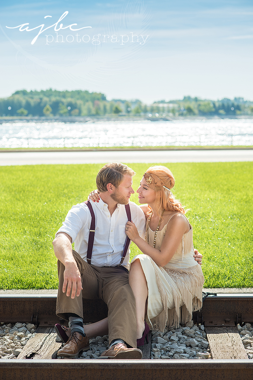 ajbcphotography-porthuron-michigan-photographer-engagement-photoshoot-michigan-ring-i-do-love-classic-vintage-old-fashion-trainstop-port-huron-museum-train-station-love-flapper-dress-outdoors-bluewater-bridge.jpg