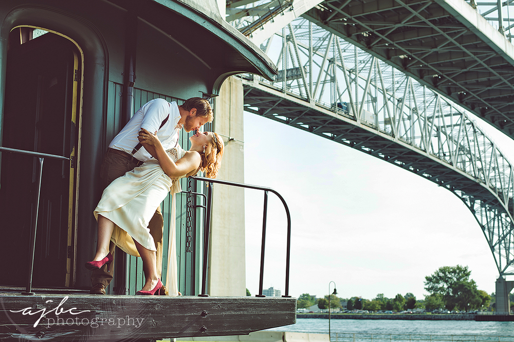 ajbcphotography-porthuron-michigan-photographer-engagement-photoshoot-michigan-ring-i-do-love-classic-vintage-old-fashion-trainstop-port-huron-museum-train-station-love-flapper-dress-vintage-photoshoot.jpg