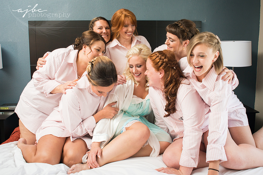 bride with bridesmaids getting ready photos.jpg