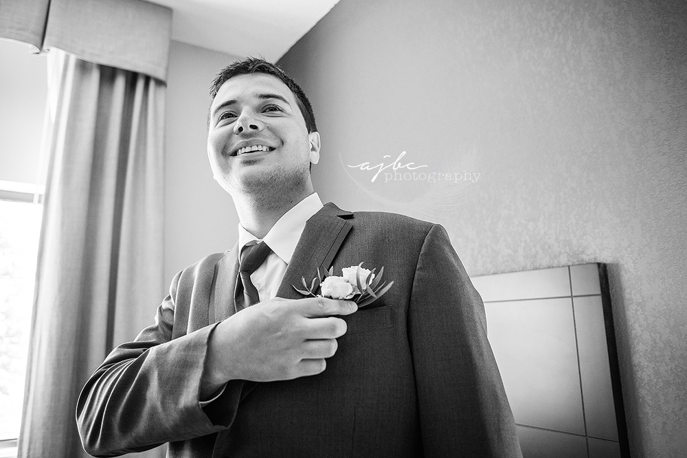 groom getting ready photos port huron michigan photographer.jpg
