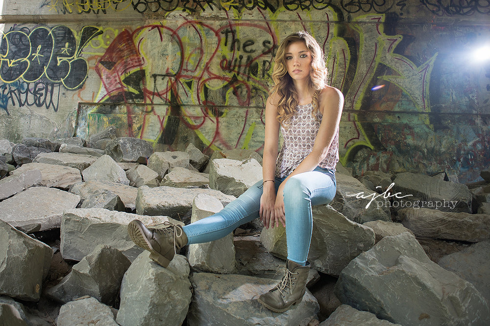 grungy senior photoshoot graffiti walls michigan photographer.jpg