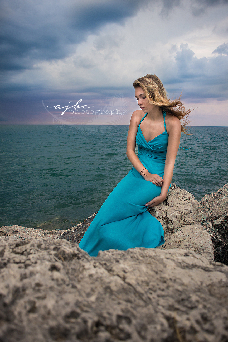 senior beauty photoshoot on the water lexington michigan photographer.jpg