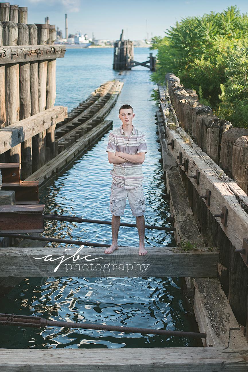 outdoor senior boy photoshoot on the water.jpg