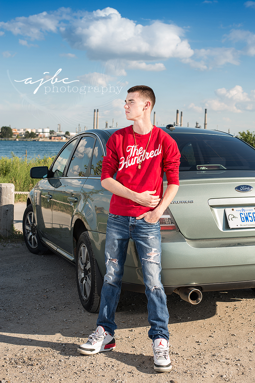senior boy photoshoot with his car on the lake michigan photographer.jpg