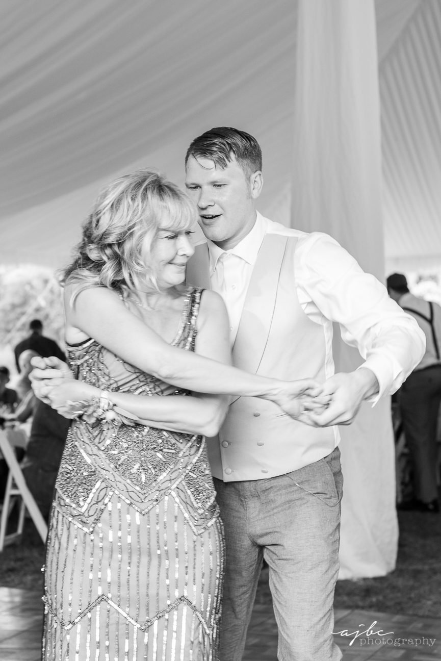 groom and mother first dance wedding photographer.jpg